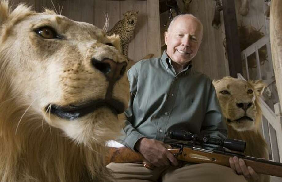 Houston billionaire Dan Duncan was photographed at his ranch surrounded by his trophies for a Chronicle profile in March 2006. Photo: BRETT COOMER, CHRONICLE FILE