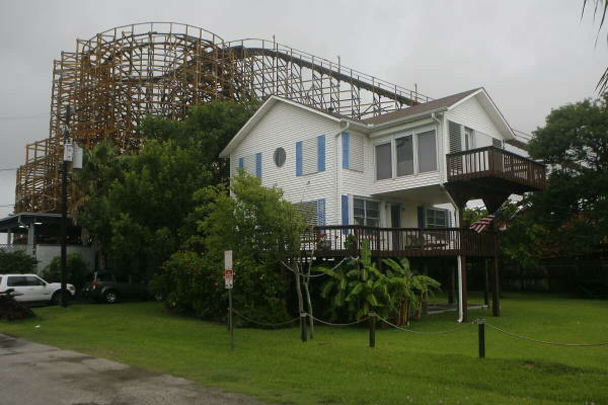 A house owned by the Killion family is being encroached on by a new roller coaster being built on the Kemah Boardwak.