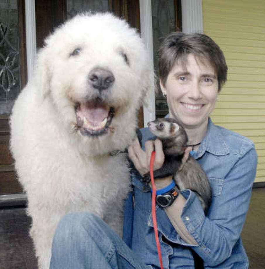 Salise Shuttlesworth, shown with her dog Gus and ferret Fiyero, is the executive director and co-founder of Friends for Life. Photo: Tim Johnson, For The Chronicle