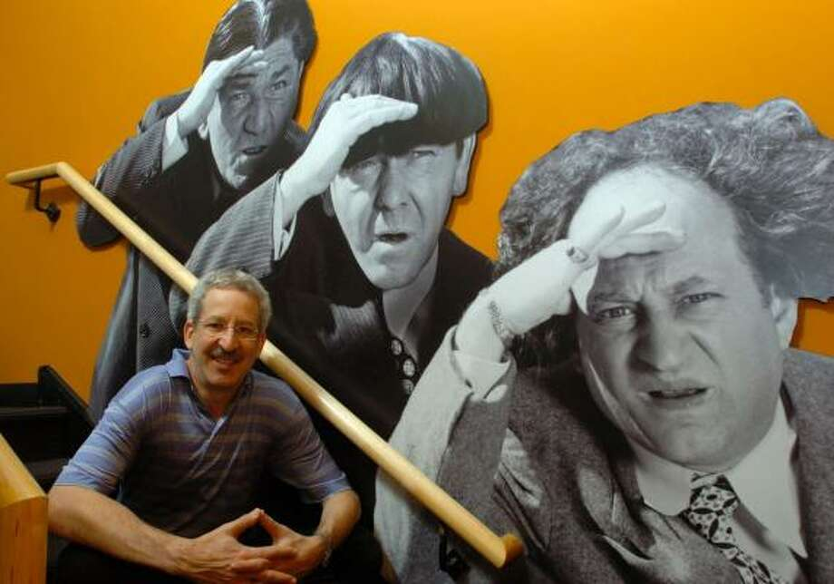 Gary Lassin sits next to three-dimensional cutouts of the Three Stooges in his Stoogeum. Photo: CATHERINE MEREDITH, ALLENTOWN MORNING CALL