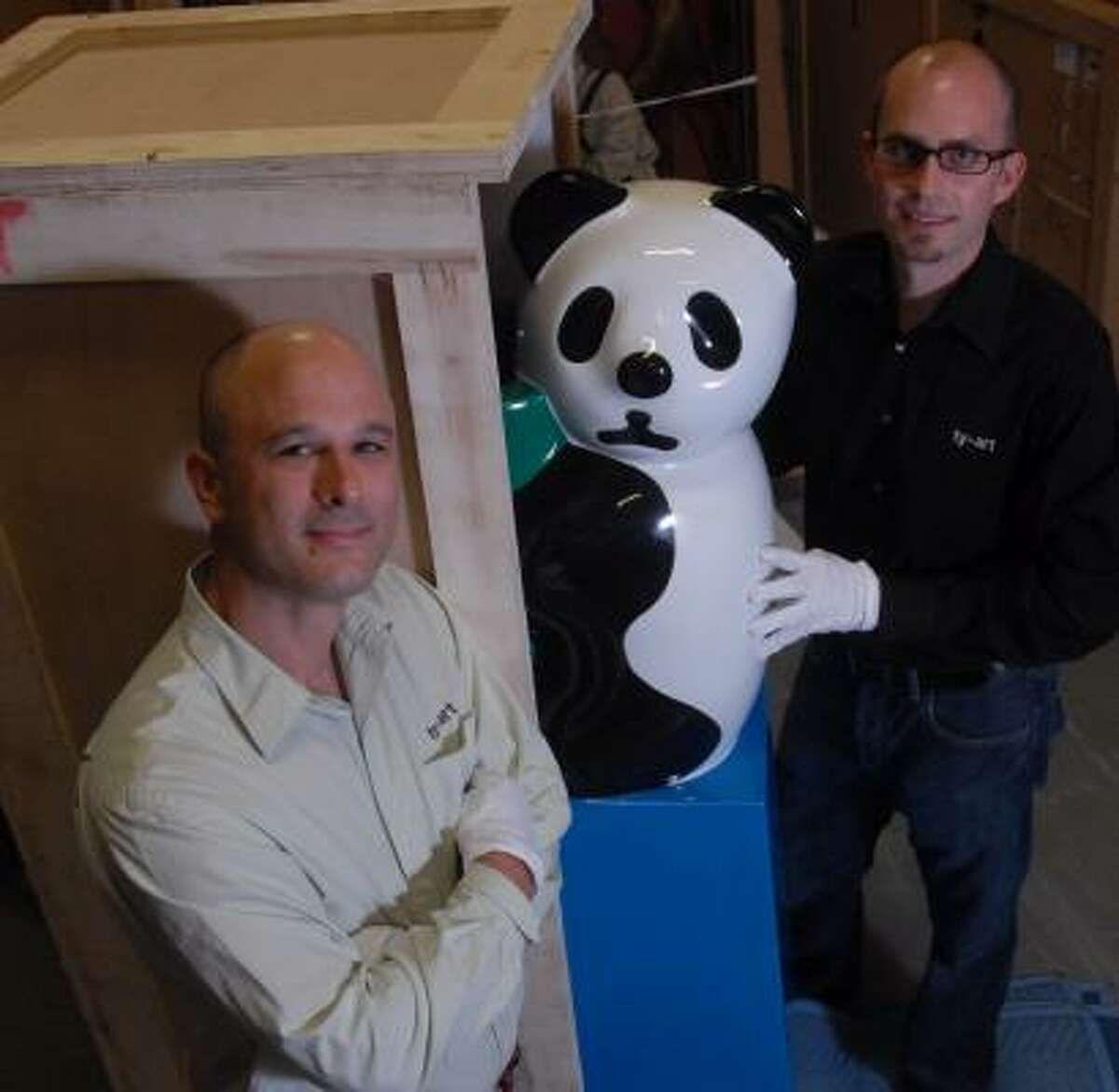 Kyle Young, left, and Christopher Tribble are co-owners of Ty-Art, an art storage and transportation company. They're in a storage facility with Sui Jianguo's Waste Beauty, a piece that will be on exhibit starting July 22 at the Houston Museum of Fine Arts.