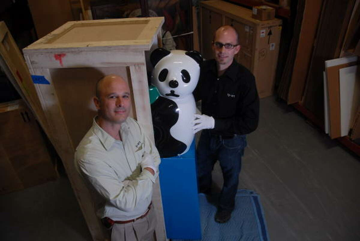 Kyle Young, left and Christopher Tribble are co-owners of Ty-Art an art storage and transportation company that packs and ships art across the country and the world.