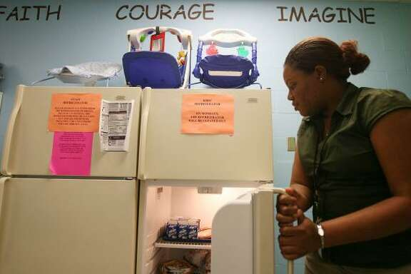 Quenetha Ferguson of the Harris County Youth Services Center shows a fully stocked refrigerator for children. An earlier privatization effort by the state once created uncertainty about the facility's future.