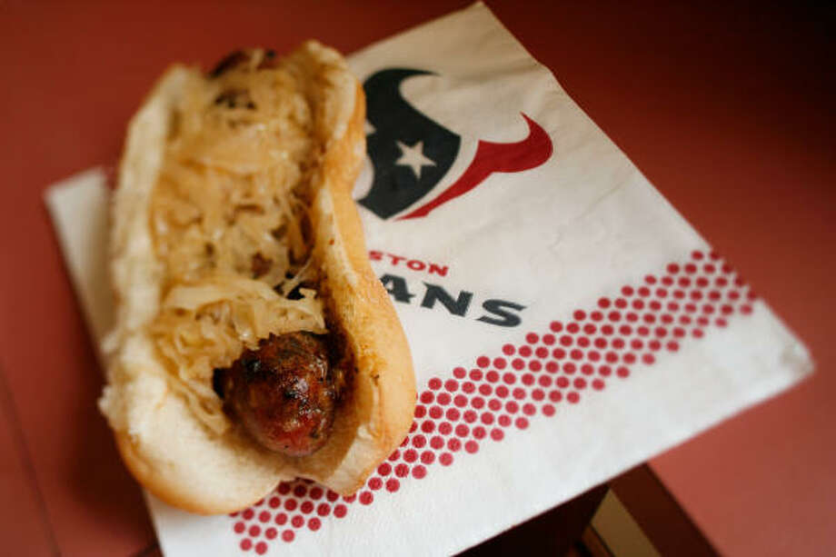TAKE A BITE:A Roddie Rowdies Texas Beer Brat is served on a toasted bun with onions, sauerkraut and whole-grain mustard. Photo: Kevin Fujii, Chronicle