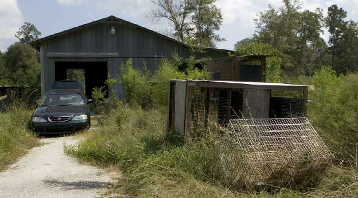 The home of Thomas Weigner Jr., who authorities say was linked to dog fighting, has stood vacant since his death last year.