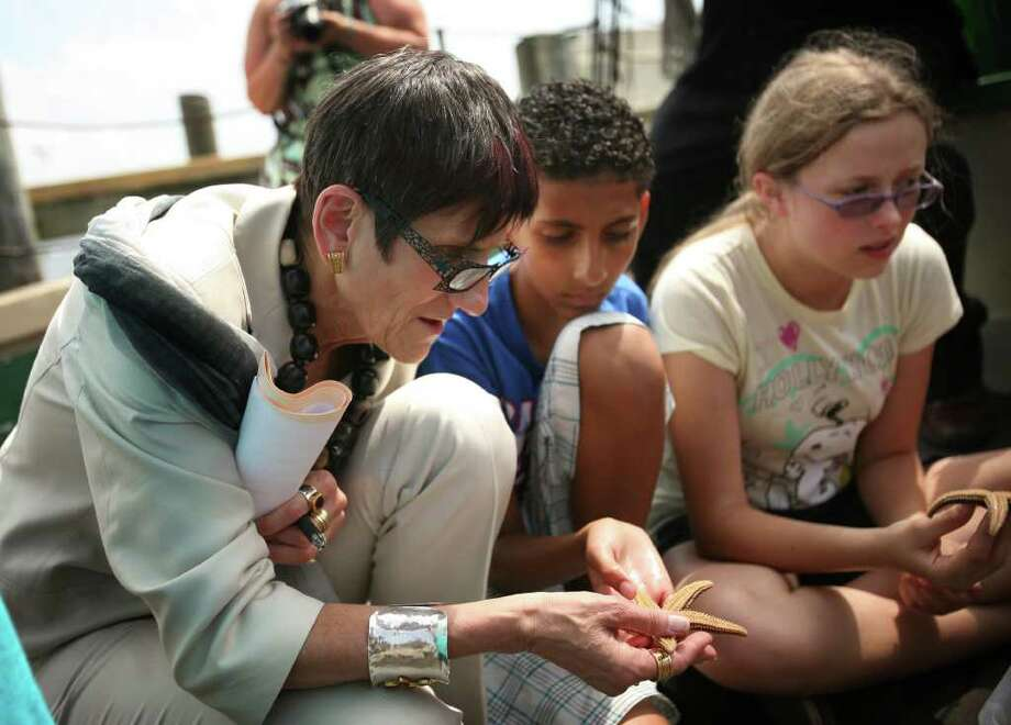 Rep. Rosa DeLauro examines a sea star along with summer campers aboard the schooner Quinnipiac in New Haven on Tuesday, August 9, 2011. DeLauro, along with the Connecticut Fund for the Environment, discussed Sound Visions, a ten year plan calling for sewer upgrades in cities and towns along the shore. Photo: Brian A. Pounds / Connecticut Post