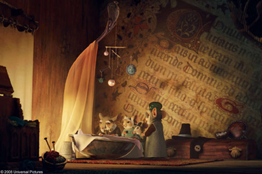 """The family gathers around Despereaux's crib in """"The Tale of Despereaux."""""""