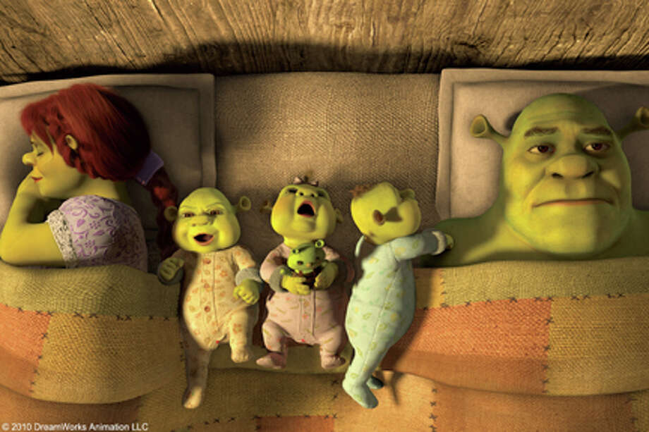 "Fiona, Shrek and children in ""Shrek Forever After."""
