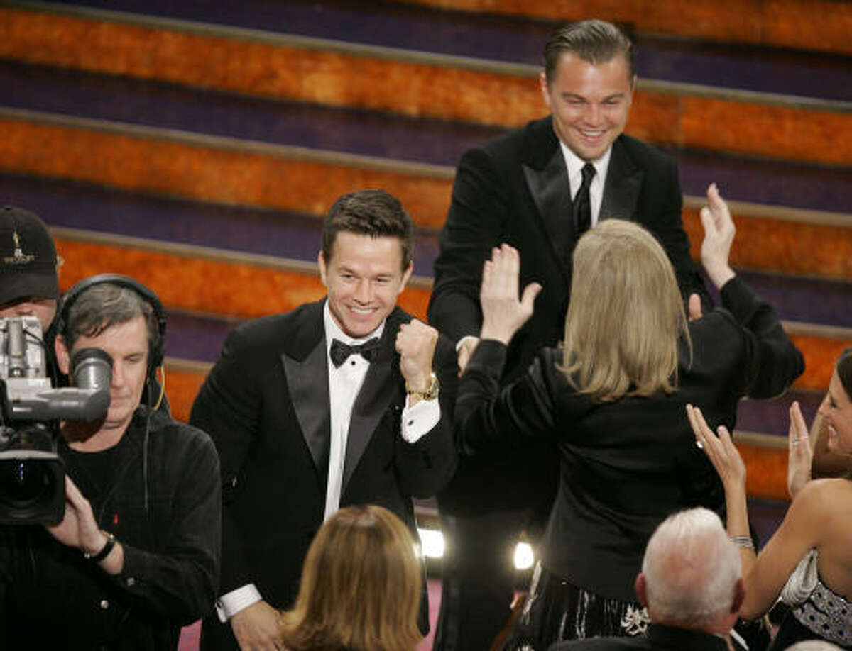 Leonardo DiCaprio, right, celebrates with Mark Wahlberg, left, and fellow cast members after The Departed won the Oscar for best motion picture, Feb. 25, in Los Angeles.