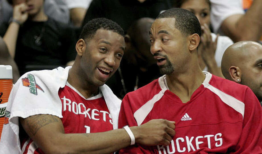 Rockets forward Tracy McGrady, left, with teammate Juwan Howard, isn't thrilled about the prospects of playing in an NBA All-Star Game in the Big Easy. Photo: John Raoux, AP