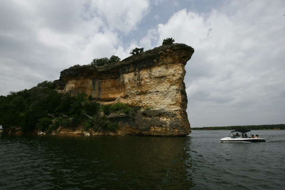 The cliff formations known as Hell's Gate rise 110 feet out of Possum Kingdom Lake. The lake is a popular spot for boaters, swimmers and skiers. And the fishing isn't too bad either. Photo: Nick De La Torre, Chronicle