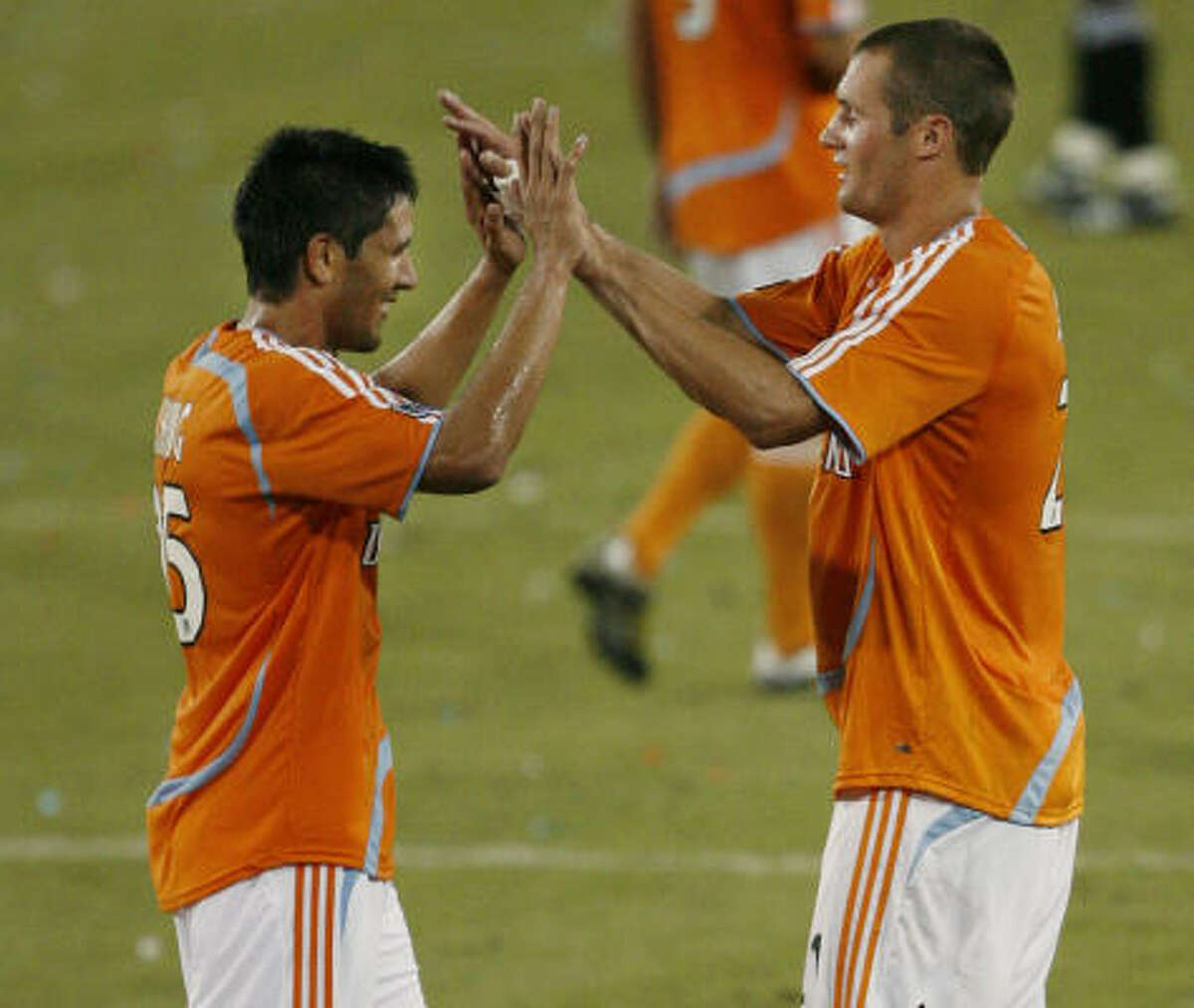 The resurgence of Brian Ching, left, and the addition of some new blood like Nate Jaqua have the Dynamo looking like championship contenders again.