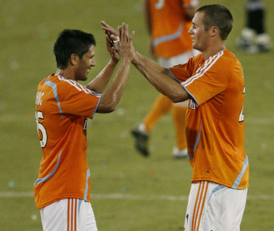 The resurgence of Brian Ching, left, and the addition of some new blood like Nate Jaqua have the Dynamo looking like championship contenders again. Photo: Kevin Fujii, Chronicle