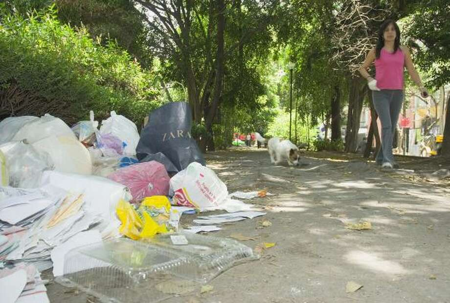 Garbage thrown into the streets is a common problem in Mexico City and the rest of the country — even in the capital city's upscale neighborhood of Condesa. Photo: KEITH DANNEMILLER, FOR THE CHRONICLE