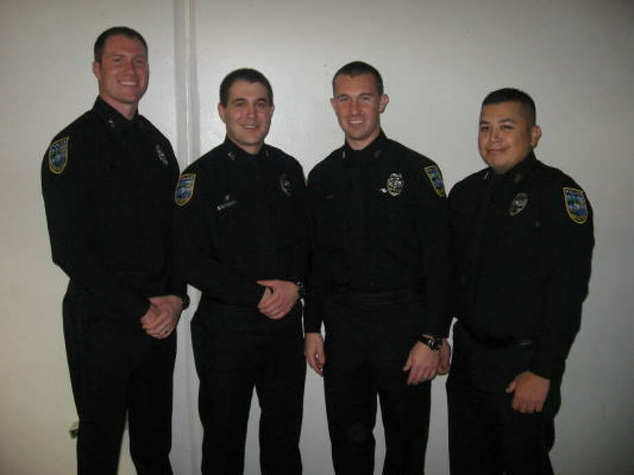 New Pearland police officers, from left, Chad Liggitt, Alex Rudenko, Clinton Pledger, and Omar Perez. Photo: Courtesy Of Pearland Police Dept