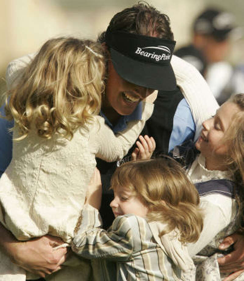Phil Mickelson daughters Sophia, left, and Amanda, right, and son Evan were waiting for him at the 18th green after he notched his 30th-career PGA win. Photo: Jeff Chiu, AP