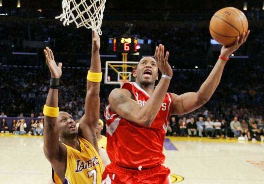 Tracy McGrady drives to the basket for two of his 30 points in Friday night's 107-104 overtime victory over the Lakers. Photo: MARK J. TERRILL, ASSOCIATED PRESS