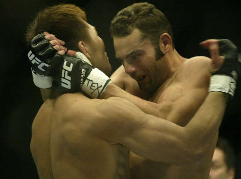 Yushin Okami, left, handed Houston-native Mike Swick his first UFC loss at Toyota Center. Photo: Jessica Kourkounis, For The Chronicle