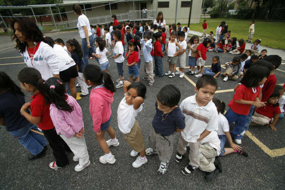 Lines form for a turn at the activities during Friday's Field Day at Pilgrim Elementary School on Richmond. The pre-kindergarten classes kick off the festivities, which go on all day for all grade levels. Photo: Steve Ueckert, Houston Chronicle