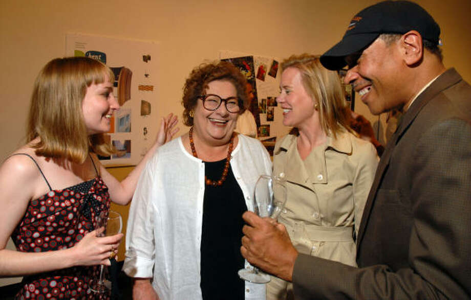 Nesta Mayo, from left, Marti Mayo, Liz Howard and John Guess Jr. make merry at Lawndale Art Center, where Marti was honored. Photo: Dave Rossman, For The Chronicle