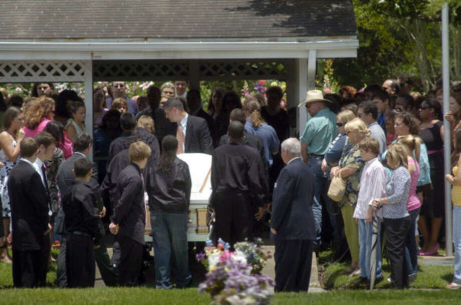 Hundreds gathered for the burial of Loral Moyers, 12, and her cousin Macy Moyers, 14, at Memory Gardens in Baytown, June 18. Photo: Johnny Hanson, For The Chronicle