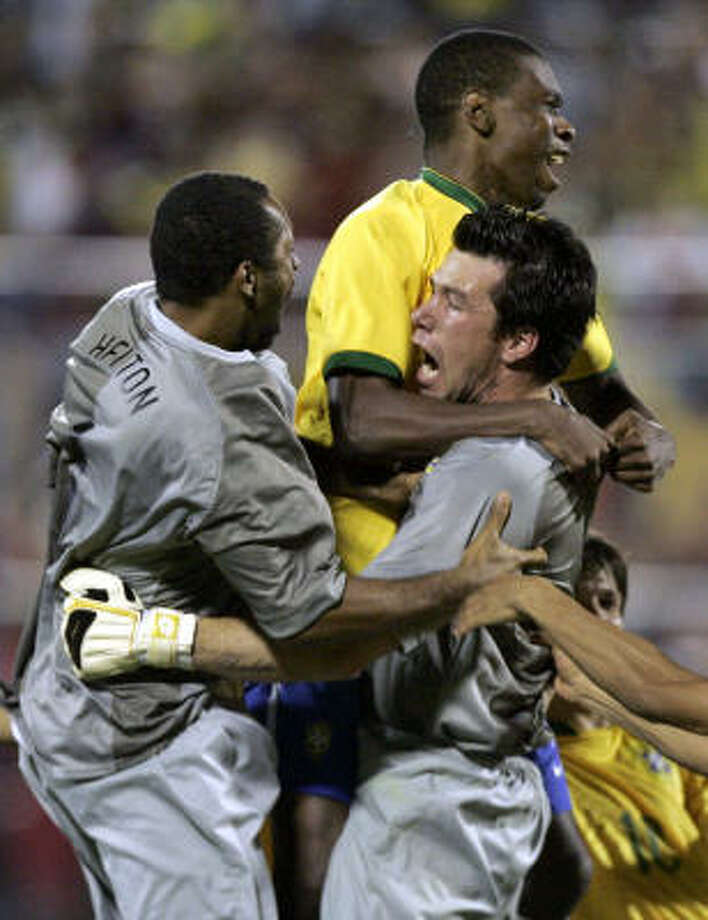 Brazil's goalkeeper Doni, right, is congratulated by his teammates Juan, center, and Helton after he stopped penalty kick from Uruguay's Diego Lugano, unseen, to qualify to the final of the Copa America in Maracibo,Venezuela. Photo: Natacha Pisarenko, AP