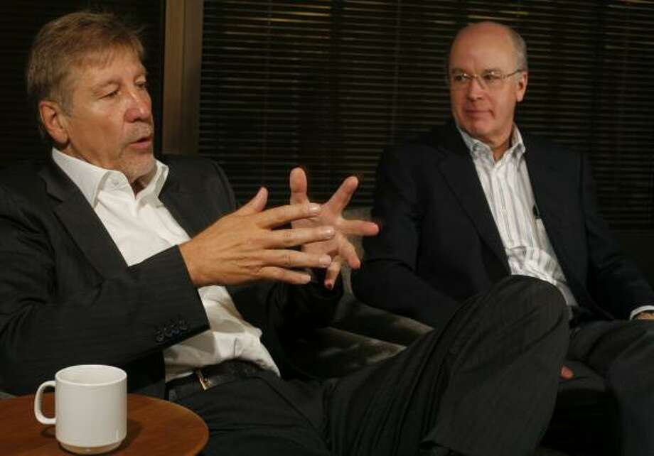 Volker Trautz, left, Basell Holdings' CEO, discusses the Dutch company's process of acquiring Lyondell with Dan Smith, the Houston-based company's CEO, on Thursday in Houston. Photo: STEVE UECKERT, CHRONICLE