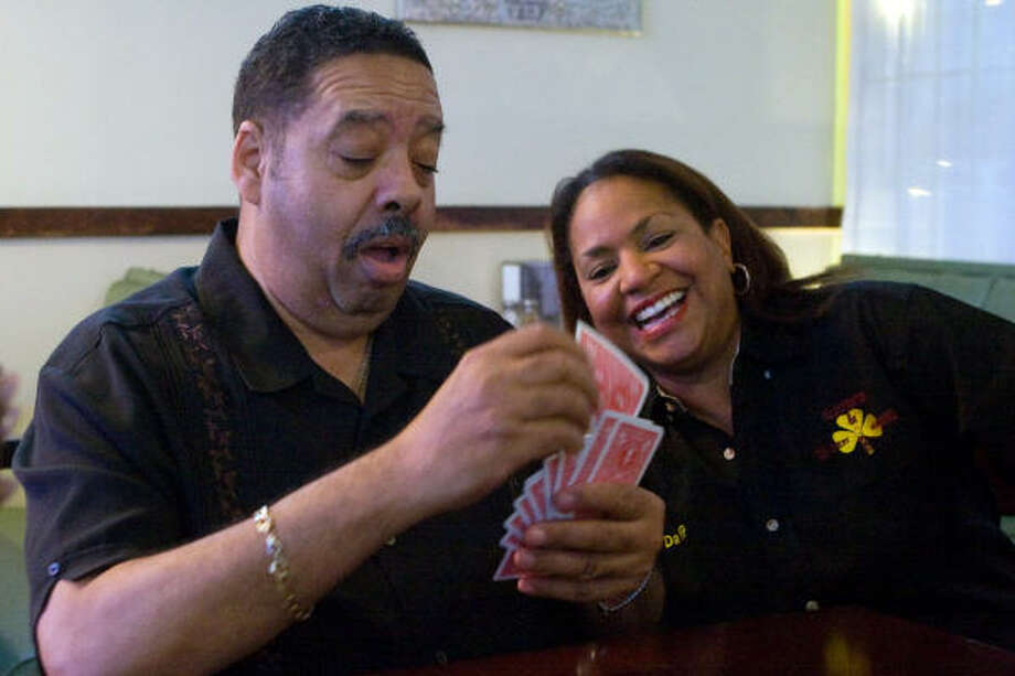 Austin Coleman, left, sorts his hand as Raven's Bid Whist and Dominos Club vice president Sheryl Thomas checks things out during a casual game of bid whist at Smokey's Barbecue, 7820 Almeda. Photo: R. Clayton McKee, For The Chronicle