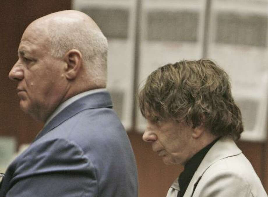 Phil Spector said he felt that defense attorney Bruce Cutler, left, had no connection with the jury in Spector's murder trial. Photo: Fred Prouser, ASSOCIATED PRESS