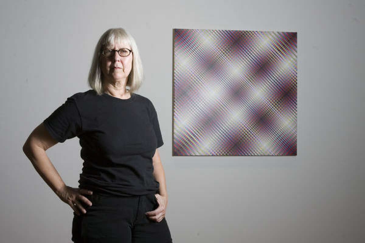Susie Rosmarin is seen with her work #377 X Painting, on view at Texas Gallery through Sept. 1.