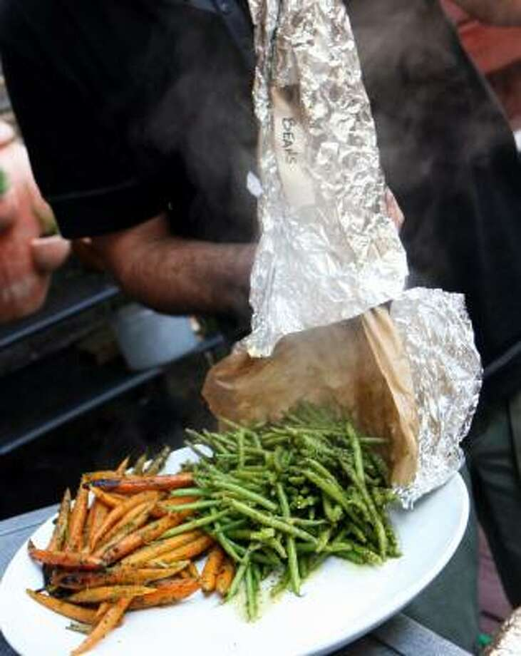 NO POTS AND PANS:Herb-seasoned vegetables grilled in foil packets go straight to the serving platter. Photo: ANDREA BRUCE, Washington Post