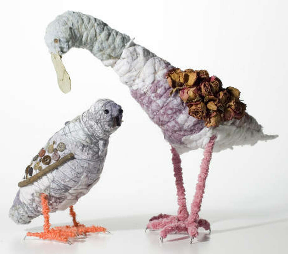 Houston artist Isabelle Chapman fashions charming shorebirds from dryer lint, buttons, pipe cleaners and dried flowers. Photo: Buster Dean, Houston Chronicle