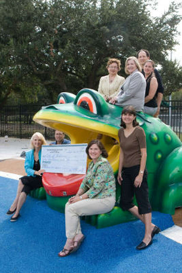 Patrons for Bellaire Parks presented a check for $1 million to the city of Bellaire for the Aquatic Center. From left, front, is Bellaire Mayor Cindy Siegel, Bellaire City Manager Bernie Satterwhite, Patrons past president Marybeth Flaherty and Patrons president Mandy Nathan. At top, left, is Polly Alam of Amegy Bank, Patrons VP for development Lynne Skinner, Patrons VP for publicity Sharon Veldman and Patrons treasurer Bill Thorogood. Photo: R Clayton McKee, For The Chronicle