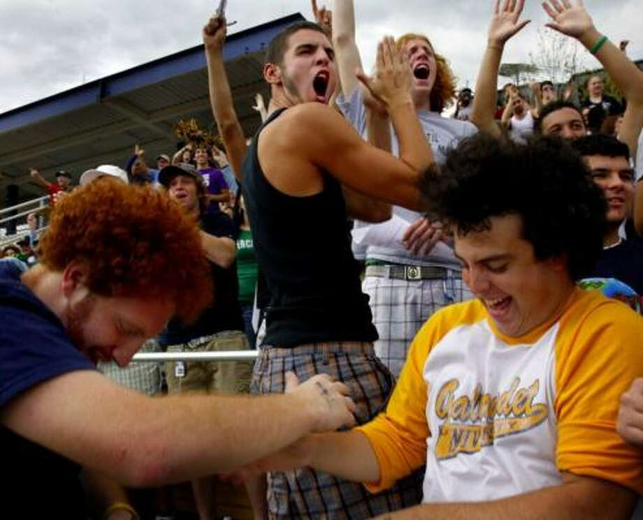 A year ago Gallaudet University was immersed in anarchy. Today, students are happier, but there are fewer of them and accreditors have put the internationally known school for the deaf on probation. Here, students cheer a Gallaudet touchdown at homecoming. Photo: MELINA MARA, WASHINGTON POST