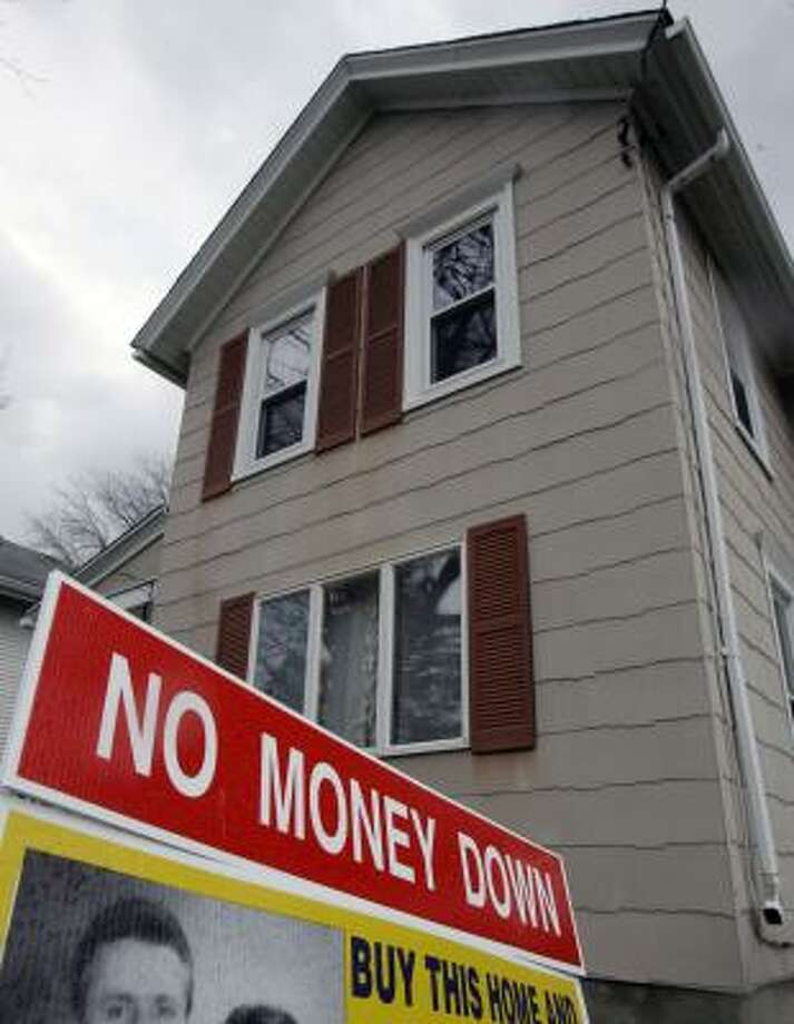 A home is offered for sale in Lockport, N.Y. The term homeowner has started to become a misnomer, with many having tapped the equity in their property for loans. Photo: David Duprey, ASSOCIATED PRESS FILE