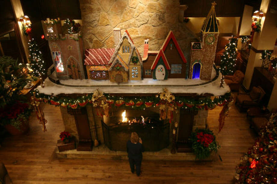 The Houstonian Hotel used 150 pounds of gingerbread, 120 pounds of royal icing, 10 pounds of sugar cookie dough, and 40 pounds of candy to create fairy-tale cottages placed on top of the fireplace. Photo: Mayra Beltrán, Chronicle