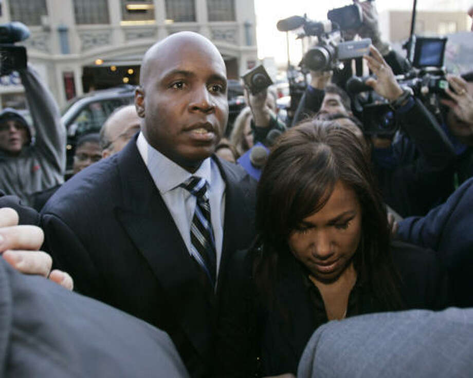 Barry Bonds and his wife, Liz, arrive Friday at the San Francisco Federal Building in San Francisco. Bonds pleaded not guilty to federal perjury and obstruction of justice charges during his hearing. Photo: Paul Sakuma, AP