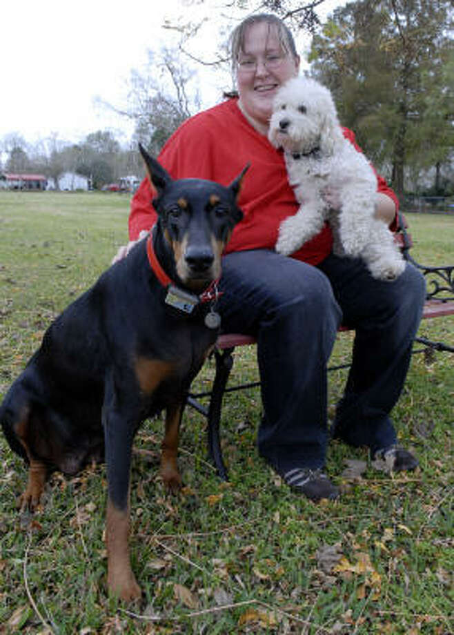 Kandace Ray sits with her dogs Magic and Trike at her home in Manvel. Photo: Kim Christensen, For The Chronicle