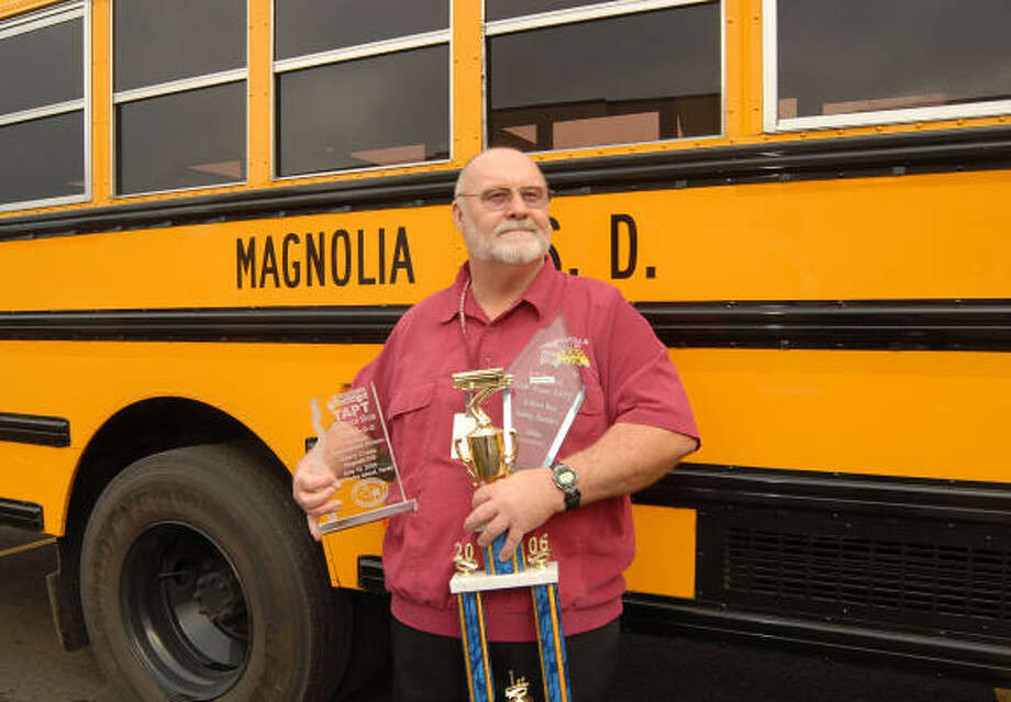 Magnolia ISD bus driver Gerry Crane holds some of the trophies he has won competing in bus rodeos for the school district. Photo: David Hopper, For The Chronicle