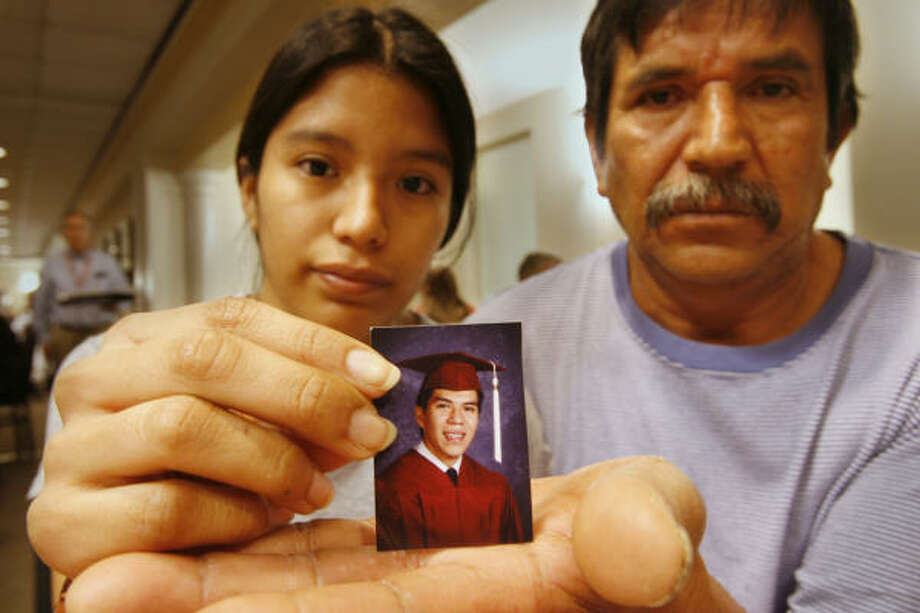 Miguel Moctezuma's twin, Nereyda, with her father Angel, says her brother also has a silly side. Photo: Kevin Fujii, Chronicle