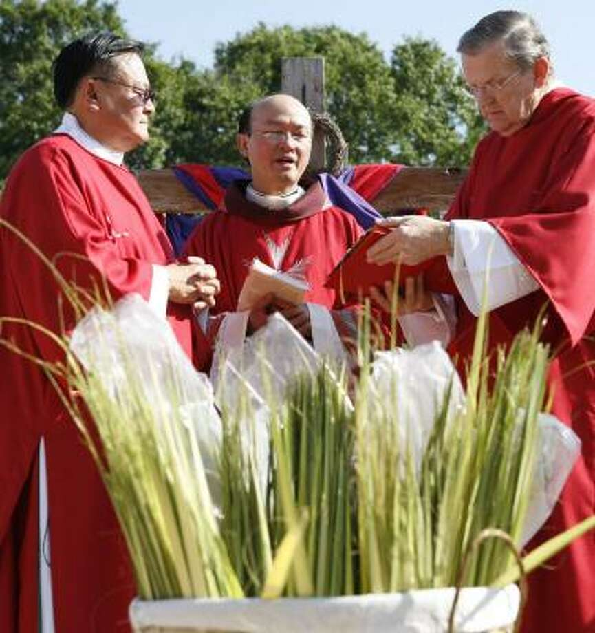 "Churches around Houston will celebrate Palm Sunday this weekend to commemorate Jesus' entry into Jerusalem. Last year at St. Bartholomew the Apostle Catholic Church in Katy, Deacon Art Chin-Fatt, from left, the Rev. ""John"" Nguyen, a visiting Dominican priest, and Deacon Bill Wagner blessed the palms before they were distributed to parishioners. Photo: KEVIN FUJII, CHRONICLE"