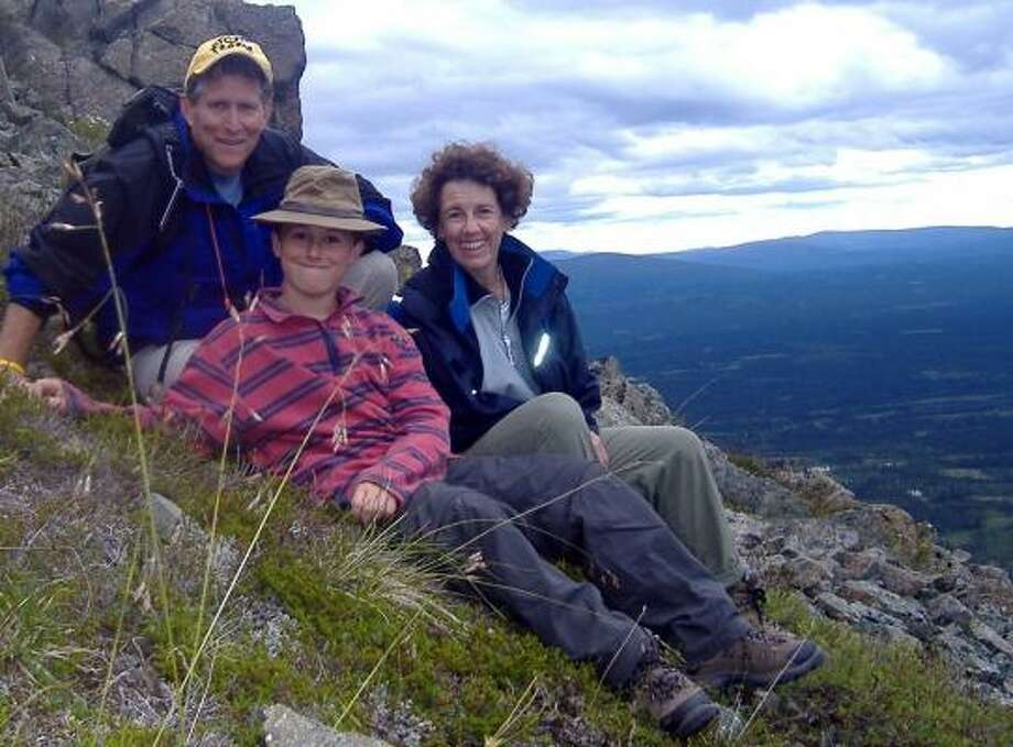 A rocky hill near Alaska's Denali Highway makes a great spot to take a break from RV driving. From left are Jason, Francis and Roberta MacInnis. Photo: JASON MacINNIS, Chronicle