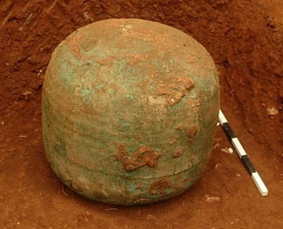 A bronze funeral urn in which archaeologists discovered 2,700-year-old fabric remains is seen in this handout photo released by the Greek Culture Ministry on Wednesday. Photo: GREEK CULTURE MINISTRY