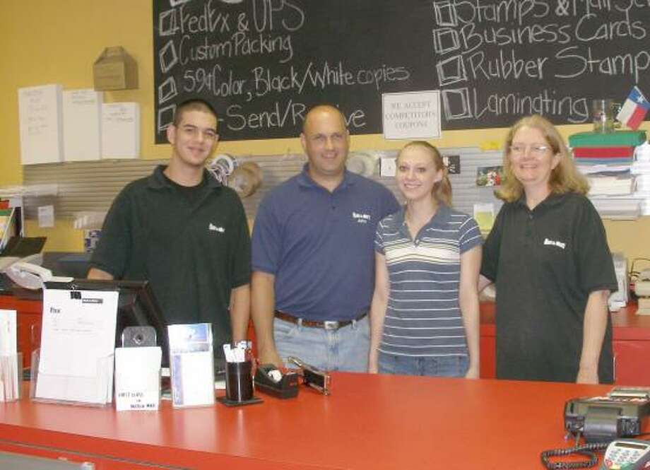 The staff members at Mail & More, from the left, are Michael Molaison, John DallePezze, Savannah Hurtt, and Bonnie Schiefelbein. Photo: Harry Williamson