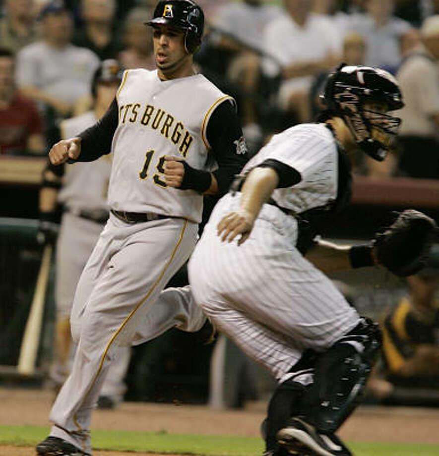 Jose Bautista (19) scores for the Pirates in the second. Photo: Pat Sullivan, AP
