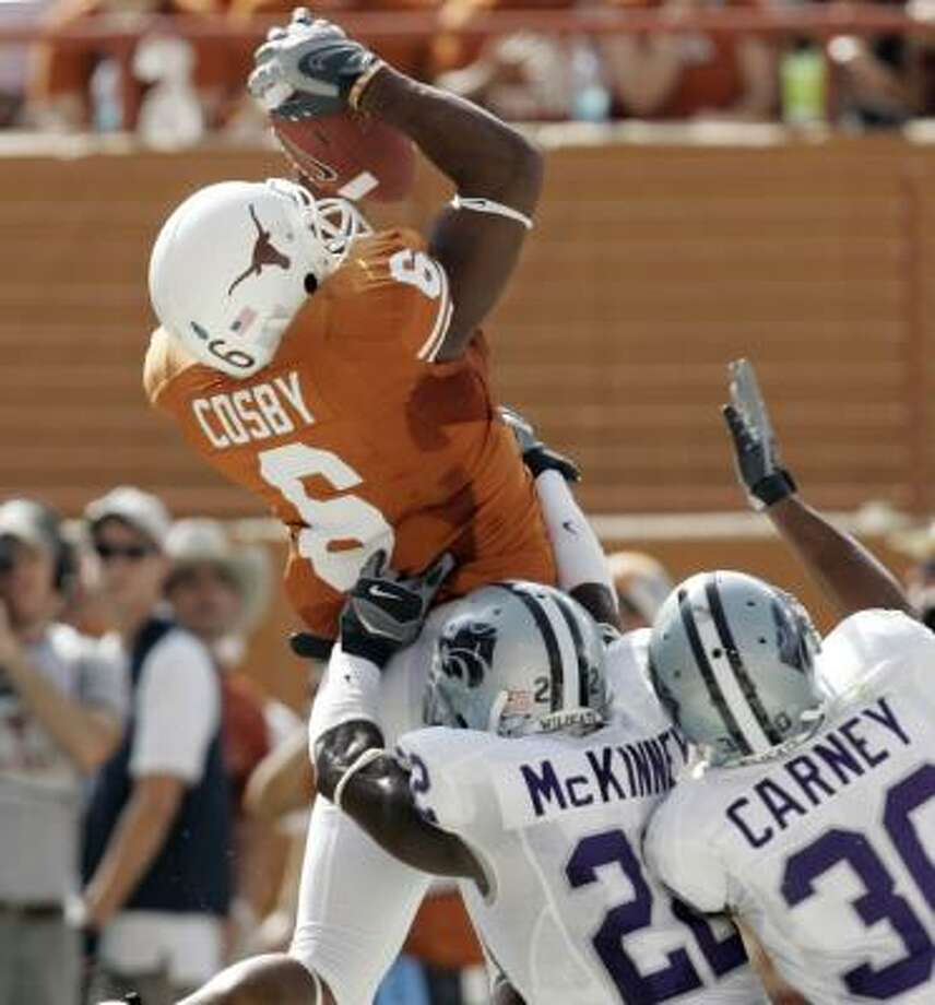 Texas' Quan Cosby, shown pulling in a touchdown pass last week, has shown he's capable of making big plays. Photo: ERIC GAY, ASSOCIATED PRESS