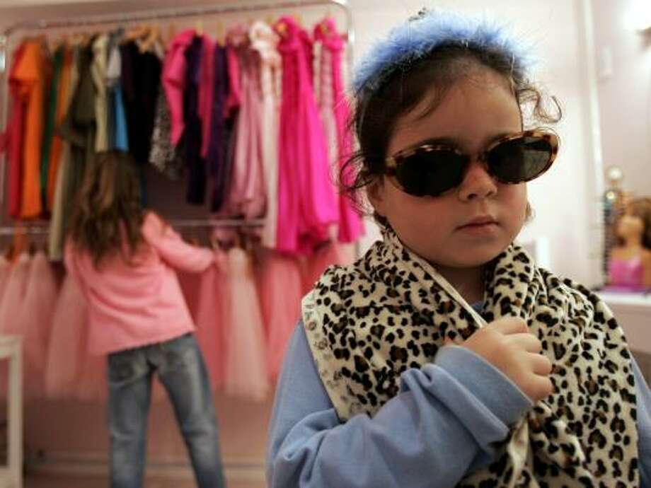 "A girl plays dress-up in the Barbie Store in Buenos Aires. The store is the world's first Barbie ""fashion-tainment"" center. Photo: NATACHA PISARENKO, ASSOCIATED PRESS"