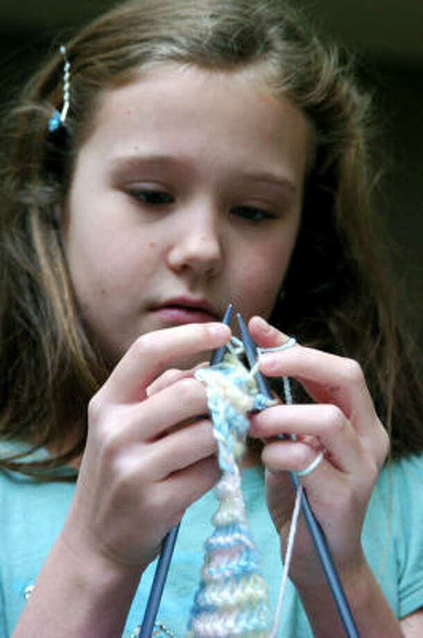 Westwood Elementary third-grader Lizzie Clements is knitting a baby cap that will be provided to a needy infant in an effort to reduce worldwide infant mortality. Photo: Kirk Sides, For The Chronicle