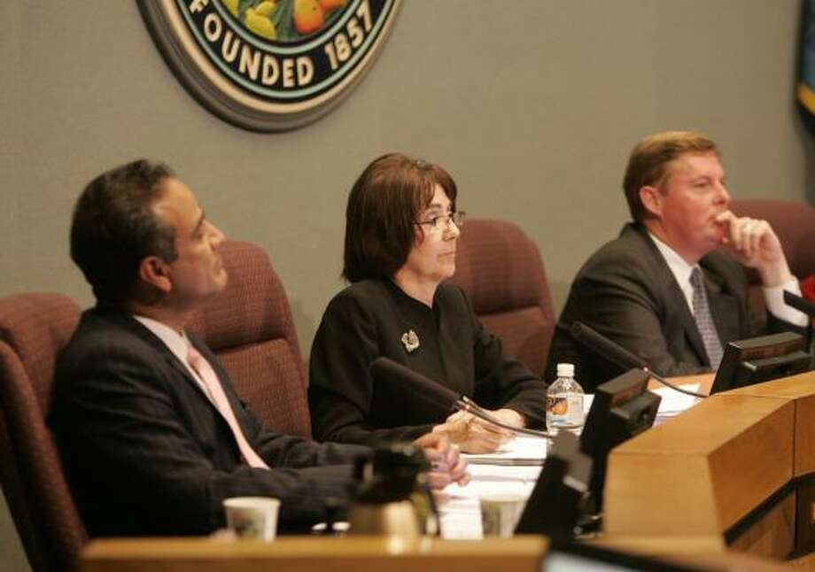 Anaheim City Council members Harry Sidho, left, and Lucille Kring and Mayor Curt Pringle listen to concerns about affordable housing before their vote on Tuesday. The council approved a zoning change, allowing the construction of low-income housing near Disneyland. Photo: ROSE PALMISANO, ORANGE COUNTY REGISTER