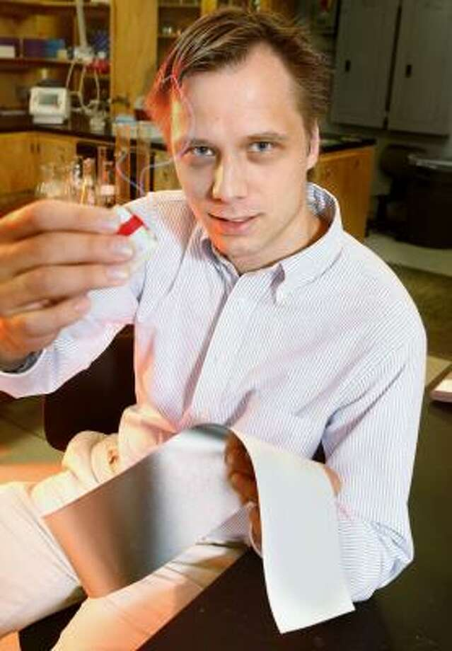 Ville Kaajakari, assistant professor of electrical engineering at Louisiana Tech University, shows a power generator that can be implanted in a shoe to produce electricity with each step. His research is funded by the Defense Department. Photo: MICHAEL DUNLAP, THE NEWS-STAR